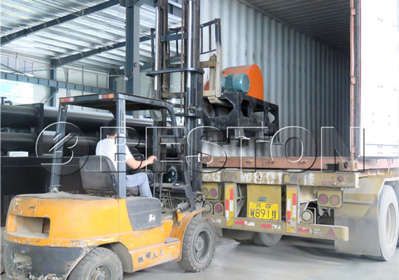 worker is carefully packing the various parts of continuous pyrolysis equipment